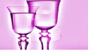 Royalty Free Video of a Rotating Wedding Cake with Wine Glasses in Front