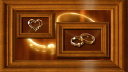 Royalty Free Video of Framed Rotating Wedding Rings and Hearts