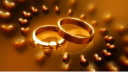 Royalty Free Video of Rotating Wedding Rings Surrounded by Rotating Hearts
