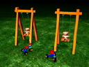 Royalty Free Video of Teddy Bears in Swings Beside Trikes