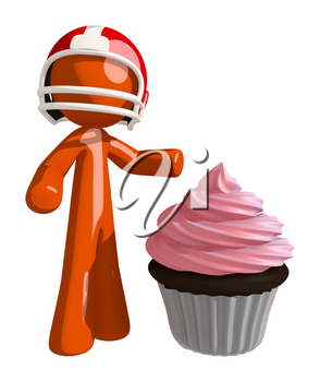 Football player orange man who has experienced a win standing beside a large party cupcake.