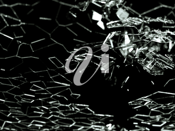 Destructed or broken glass pieces on black background. shallow DOF