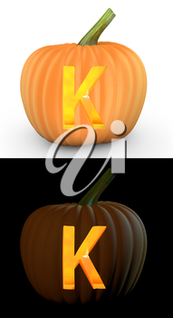 K letter carved on pumpkin jack lantern isolated on and white background
