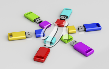 Group of usb memory sticks with different colors on shiny grey background
