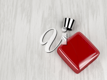 Red perfume bottle on wood background
