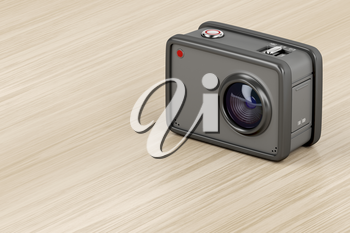 3D illustration of action cam on wooden table