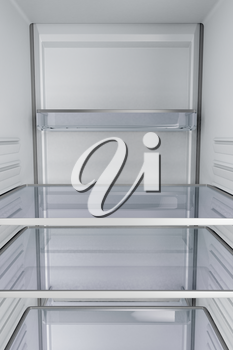 View from inside of an empty fridge with closed door