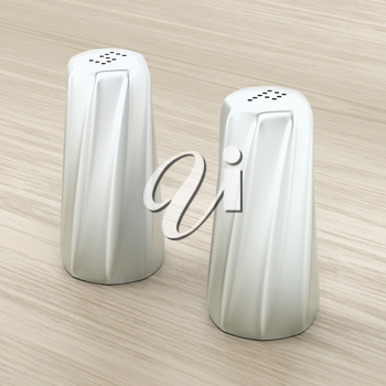 Metal salt and pepper shakers on wood background