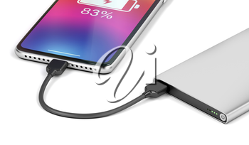 Smartphone charging with silver power bank, close-up
