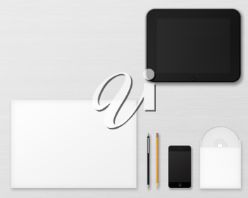 Office supplies for designers presentations and portfolios on wooden background. Above view.