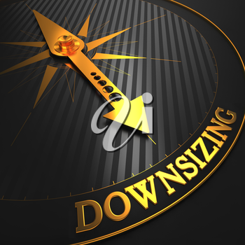 Downsizing - Business Concept. Golden Compass Needle on a Black Field Pointing to the Word Downsizing. 3D Render.
