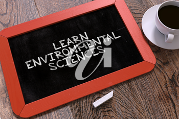 Hand Drawn Learn Environmental Sciences Concept  on Small Red Chalkboard. Business Background. Top View. 3d Render.