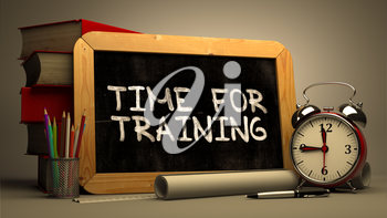 Time for Training - Chalkboard with Hand Drawn Text, Stack of Books, Alarm Clock and Rolls of Paper on Blurred Background. Toned Image. 3d Render.