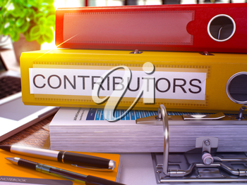 Yellow Ring Binder with Inscription Contributors on Background of Working Table with Office Supplies and Laptop. Contributors Business Concept on Blurred Background. 3D Render.
