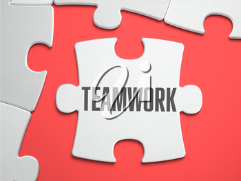 Teamwork - Text on Puzzle on the Place of Missing Pieces. Scarlett Background. Closeup. 3d Illustration.