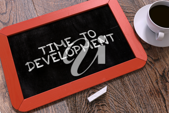 Time to Development Concept Hand Drawn on Red Chalkboard on Wooden Table. Business Background. Top View. 3D Render.