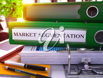 Market Segmentation - Green Office Folder on Background of Working Table with Stationery and Laptop. Market Segmentation Business Concept on Blurred Background. Market Segmentation Toned Image. 3D.