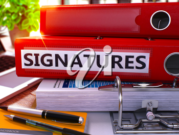 Red Ring Binder with Inscription Signatures on Background of Working Table with Office Supplies and Laptop. Signatures Business Concept on Blurred Background. 3D Render.