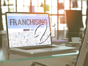 Franchising Concept - Closeup on Landing Page of Laptop Screen in Modern Office Workplace. Toned Image with Selective Focus. 3D Render.
