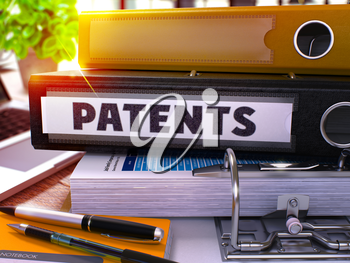 Black Office Folder with Inscription Patents on Office Desktop with Office Supplies and Modern Laptop. Patents Business Concept on Blurred Background. Patents - Toned Image. 3D.