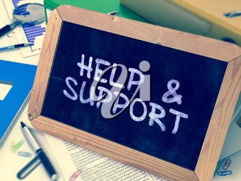 Handwritten Help and Support on a Chalkboard. Composition with Chalkboard and Ring Binders, Office Supplies, Reports on Blurred Background. Toned Image. 3D Render.