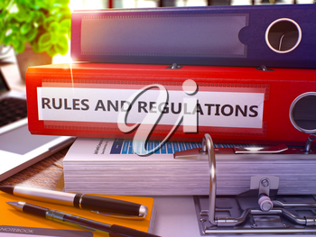 Rules And Regulations - Red Ring Binder on Office Desktop with Office Supplies and Modern Laptop. Rules And Regulations Business Concept on Blurred Background. 3D Render.