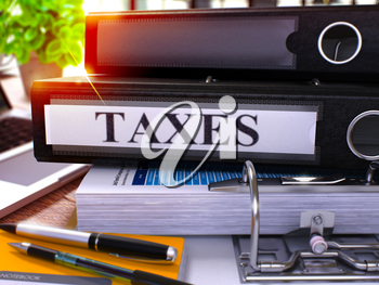 Taxes - Black Ring Binder on Office Desktop with Office Supplies and Modern Laptop. Taxes Business Concept on Blurred Background. Taxes - Toned Illustration. 3D Render.