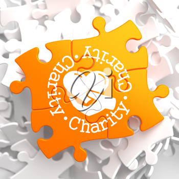 Charity Word Written Arround Icon of Heart in the Hand, Located on Orange Puzzle. Social Concept.