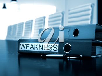 Weakness - Ring Binder on Desktop. Office Folder with Inscription Weakness on Black Wooden Desk. 3D.