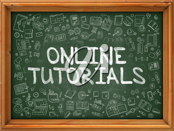 Online Tutorials - Hand Drawn on Green Chalkboard with Doodle Icons Around. Modern Illustration with Doodle Design Style.
