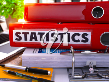 Statistics - Red Office Folder on Background of Working Table with Stationery and Laptop. Statistics Business Concept on Blurred Background. Statistics Toned Image. 3D.