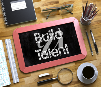 Build Talent - Red Small Chalkboard with Hand Drawn Text and Stationery on Office Desk. Top View. Build Talent on Small Chalkboard. 3d Rendering.