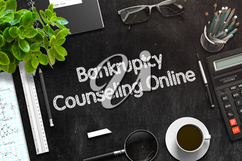 Black Chalkboard with Handwritten Business Concept - Bankruptcy Counseling Online - on Black Office Desk and Other Office Supplies Around. Top View. 3d Rendering. Toned Image.