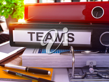Teams - Black Office Folder on Background of Working Table with Stationery and Laptop. Teams Business Concept on Blurred Background. Teams Toned Image. 3D.