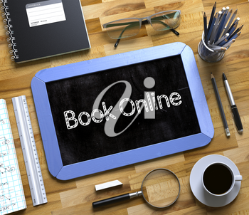 Top View of Office Desk with Stationery and Blue Small Chalkboard with Business Concept - Book Online. Book Online - Text on Small Chalkboard.3d Rendering.