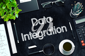 Data Integration. Business Concept Handwritten on Black Chalkboard. Top View Composition with Chalkboard and Office Supplies. 3d Rendering. Toned Image.