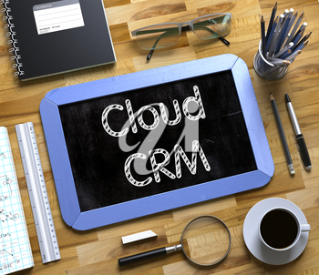 Top View of Office Desk with Stationery and Blue Small Chalkboard with Business Concept - Cloud CRM. Cloud CRM Concept on Small Chalkboard. 3d Rendering.