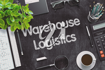 Black Chalkboard with Handwritten Business Concept - Warehouse Logistics - on Black Office Desk and Other Office Supplies Around. Top View. 3d Rendering. Toned Illustration.