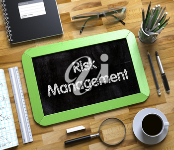Green Small Chalkboard with Handwritten Business Concept - Risk Management - on Office Desk and Other Office Supplies Around. Top View. Risk Management - Text on Small Chalkboard.3d Rendering.
