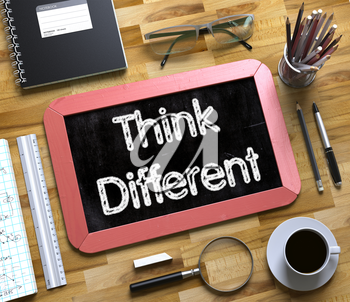 Think Different - Red Small Chalkboard with Hand Drawn Text and Stationery on Office Desk. Top View. Think Different Handwritten on Small Chalkboard. 3d Rendering.
