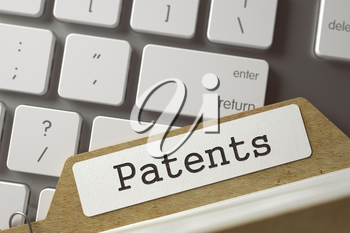 Patents written on  File Card on Background of White PC Keyboard. Archive Concept. Closeup View. Toned Blurred  Illustration. 3D Rendering.