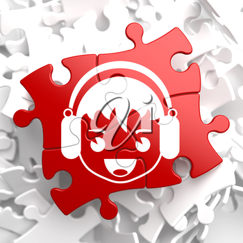Happy Boy with Headphones Icon on Red Puzzle. Sound Concept.