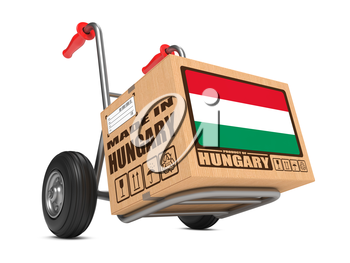 Cardboard Box with Flag of Hungary and Made in Hungary Slogan on Hand Truck White Background. Free Shipping Concept.