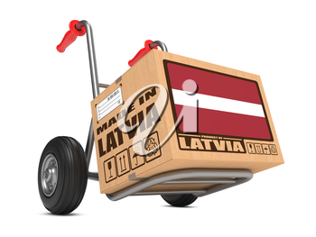 Cardboard Box with Flag of Latvia and Made in Latvia Slogan on Hand Truck White Background. Free Shipping Concept.