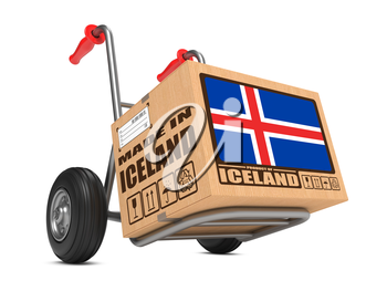 Cardboard Box with Flag of Iceland and Made in Iceland Slogan on Hand Truck White Background. Free Shipping Concept.