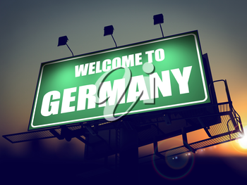 Welcome to Germany - Green Billboard on the Rising Sun Background.