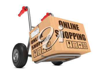 Cardboard Box with Online Shopping Slogan on Hand Truck White Background.