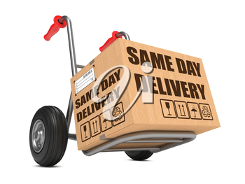 Cardboard Box with Same Day Delivery Slogan on Hand Truck White Background.