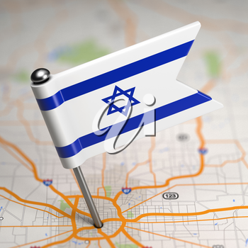 Small Flag of Israel Sticked in the Map Background with Selective Focus.