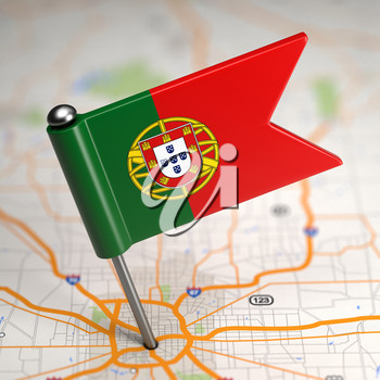 Small Flag of Portugal Sticked in the Map Background with Selective Focus.